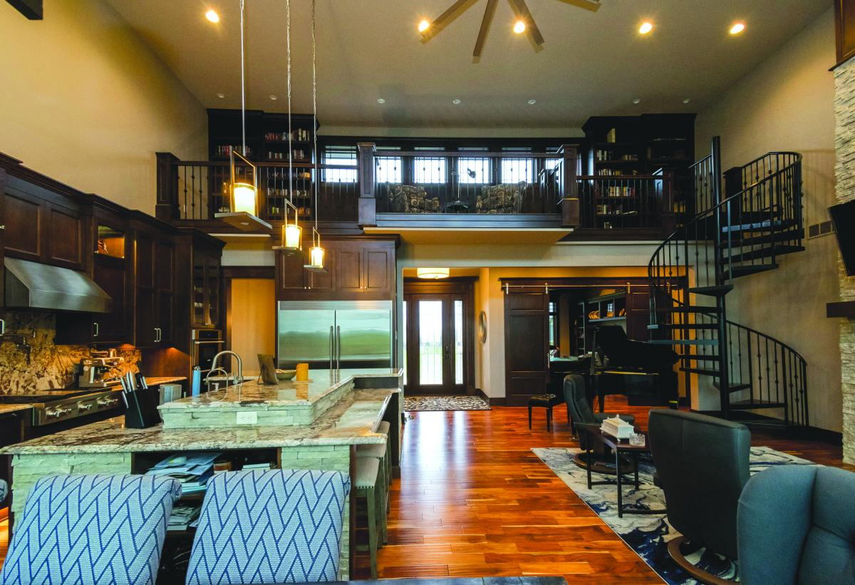Upper loft overlooks large kitchen in new Norwalk Iowa home.