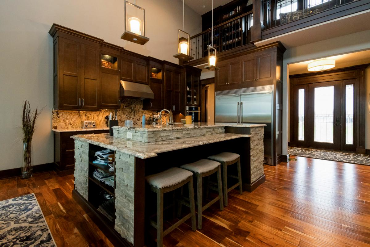 Custom built kitchen island and cabinetry by Brighton Homes, located in Norwalk Iowa.