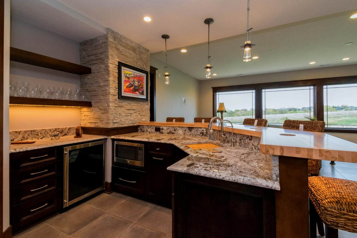 Norwalk Iowa Prairie Style Home features large, custom kitchen with island.