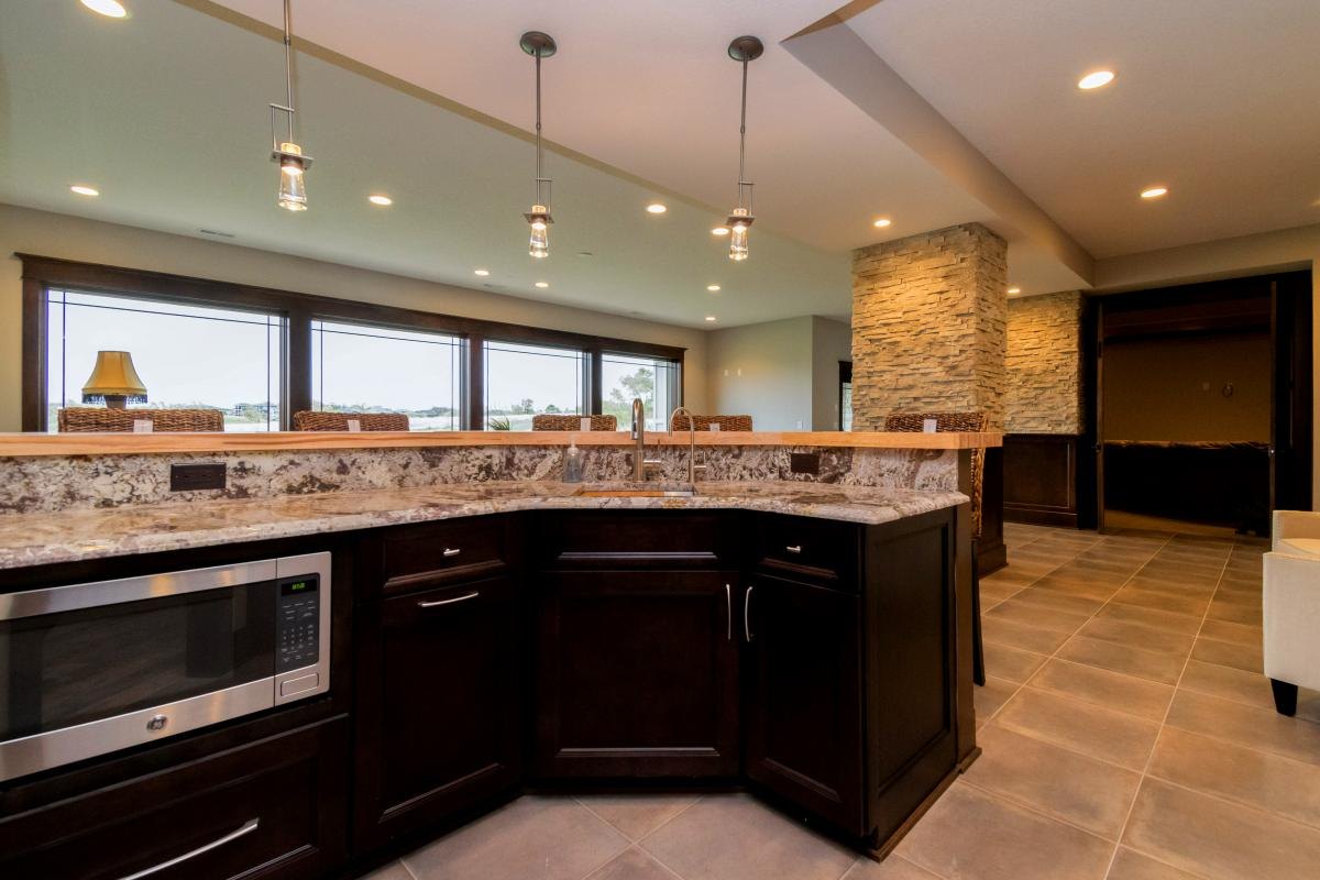 Stone wall accents and custom cabinetry are part of this Norwalk Iowa home.