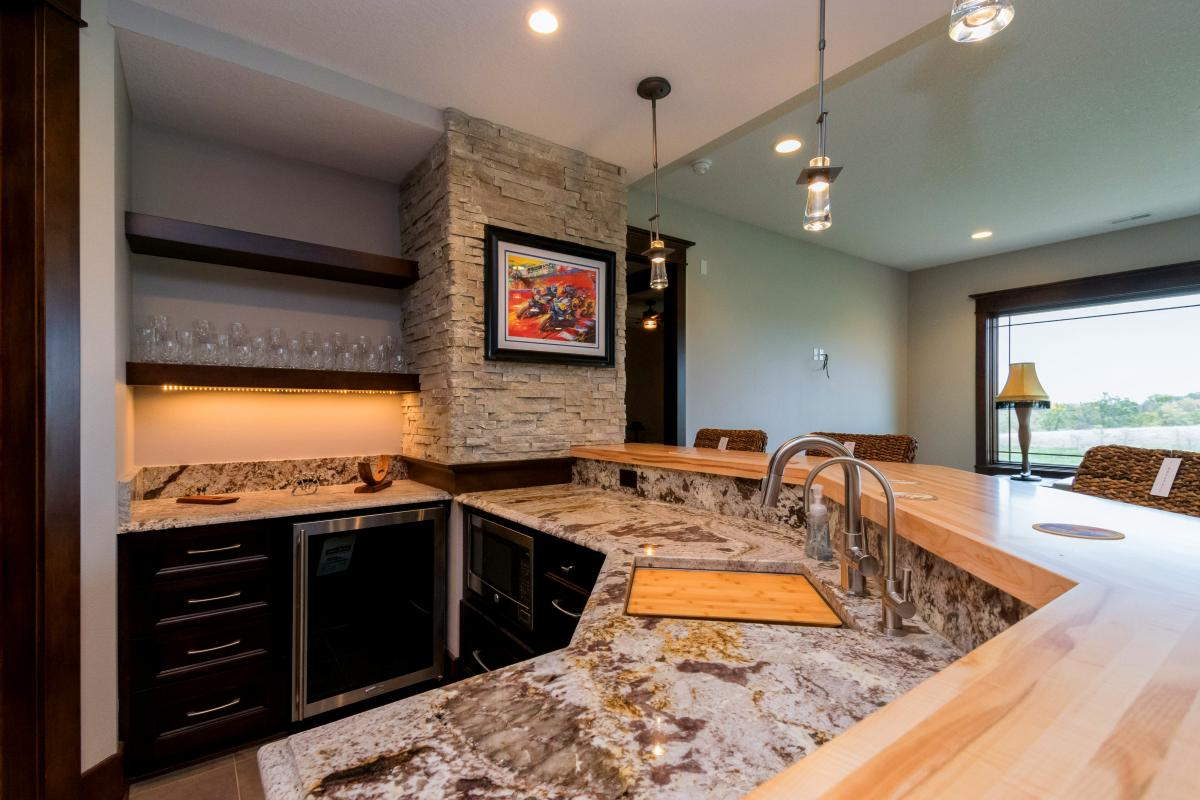 Custom countertops and lighting in the Prairie Style home located in Norwalk Iowa.