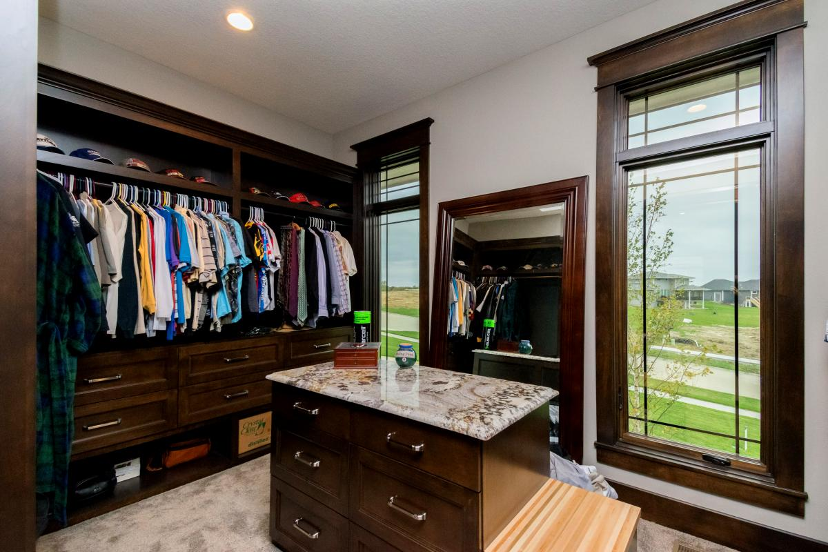 Huge walk-in closet and dressing area included in the Norwalk Iowa Prairie Style house